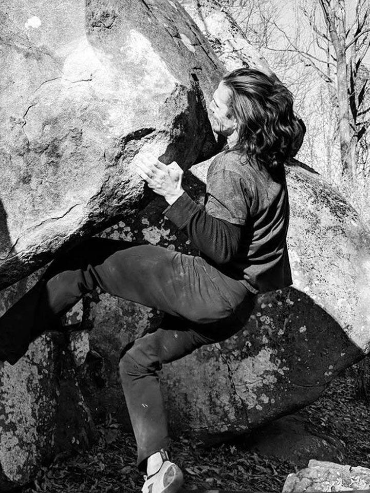 Tom Meehan climbing a rock face